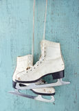 Pair of  ice skates on blue wooden background Stock Photos