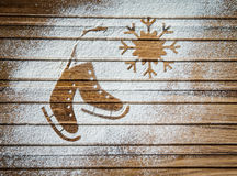 Pair of ice skates and a snowflake - background on vintage, retro style. Winter holidays card with ice skates shape made of flour. Royalty Free Stock Photos