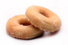 Pair of iced doughnuts. Image of two doughnuts on a white background Royalty Free Stock Photo