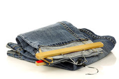 Pair of jeans with a clothes hanger Stock Photos