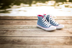 Pair of jeans sneakers  on the wood Stock Photo