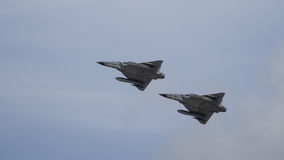 Pair of jet fighters in flight Royalty Free Stock Image