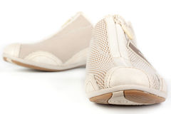 A pair of jogging shoes. On a white background Royalty Free Stock Images