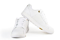 A pair jogging shoes. White jogging shoes on a white background Royalty Free Stock Photo