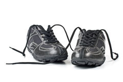 A pair jogging shoes. Black jogging shoes on a white background Stock Photos
