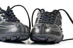 A pair jogging shoes. Black jogging shoes on a white background Royalty Free Stock Photography