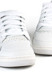 A pair jogging shoes. White jogging shoes on a white background Stock Image
