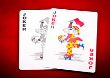 Pair of joker. A pair of two jokers on red background Royalty Free Stock Photos