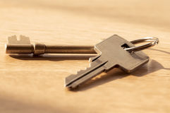 Pair of keys on the table close up Royalty Free Stock Images