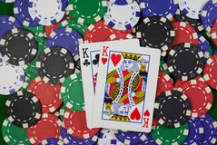 Pair of kings. Poker, hand - pocket kings clubs and hearts on colorful chips Royalty Free Stock Photos