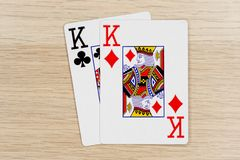 Pair of kings - casino playing poker cards. Pair of kings - winning hand of gambling casino poker playing cards on a table royalty free stock photography