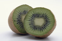 A Pair of Kiwi slices shows cooperation Stock Image