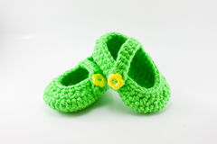 Pair of knitted, bright green baby booties. A pair of knitted, bright green baby booties Royalty Free Stock Image