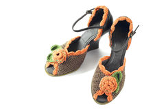 Pair of knitted shoes Stock Images