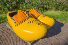 Pair of large yellow wooden shoes in Zaanse Schans Royalty Free Stock Images