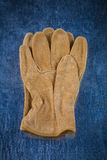 Pair of leather brown working gloves on scratched Stock Photo