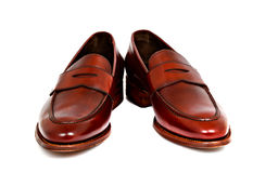 Pair of leather cherry calf penny loafer shoes together at angle Royalty Free Stock Image