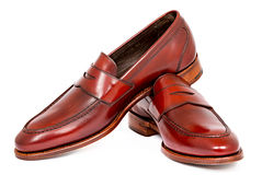 Pair of leather cherry calf penny loafer shoes together Royalty Free Stock Photos