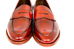 Pair of leather cherry calf penny loafer shoes together one by one closely Stock Image