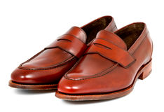 Pair of leather cherry calf penny loafer shoes together one by one diagonal left Royalty Free Stock Image