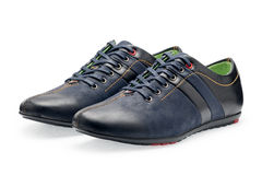 Pair leather dark blue color male sport shoes with shoelaces Royalty Free Stock Image