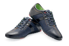 Pair leather dark blue color male sport shoes with shoelaces Stock Image