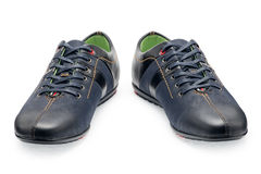 Pair leather dark blue color male sport shoes with shoelaces Stock Images