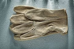 Pair of leather safety gloves on concrete background Stock Photography