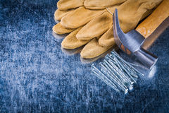 Pair of leather safety gloves construction nails and claw hammer Stock Images