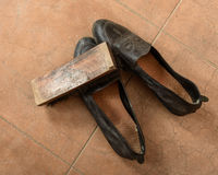 Pair of leather shoes and brush Stock Image