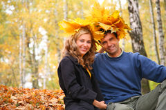 Pair with leaves on head in autumn wood Royalty Free Stock Photography