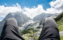 Pair of leggs with a mountain view Stock Photos