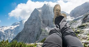 Pair of leggs stretched into the air with a mountain view Royalty Free Stock Image