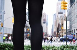 A pair of legs standing in a city. royalty free stock photos