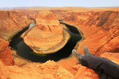Pair of legs at Horseshoe bend overlook Stock Images