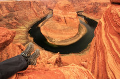 Pair of legs at Horseshoe bend overlook Stock Photography