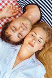 Pair lies to head closed eyes Royalty Free Stock Photo