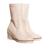 Pair of light beige boots Stock Images