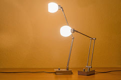 A pair of lit lamps Royalty Free Stock Photography