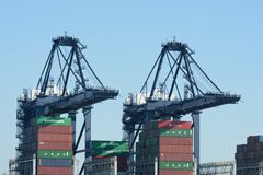 Pair of Loading Cranes with Containers Stock Photos