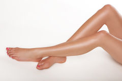 Pair of long female legs Stock Image