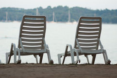 Pair of loungers on the beach Royalty Free Stock Photo