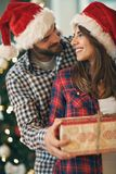 Pair in love with Christmas gift Royalty Free Stock Images
