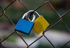 Pair of love locks joined together stock photography