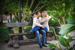 Pair of lovers on a bench in autumn Royalty Free Stock Photography