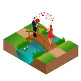 Pair of lovers on bridge. Romantic couple in love meeting. Love and celebrate concept. Man gives a woman a bouquet of Royalty Free Stock Image
