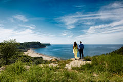 A pair of lovers on a cliff Stock Images