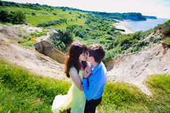 A pair of lovers on a cliff Royalty Free Stock Photo