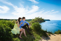 A pair of lovers on a cliff Stock Photography