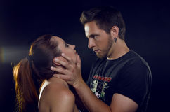 A pair of lovers. The guy grabbed the girl's face with his hands Royalty Free Stock Photography